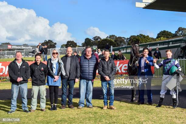 Connections pose with Eurack and trainer Nathan McPherson and jockey Ben Melham after winning the Comcater Handicap at Ladbrokes Park Hillside...