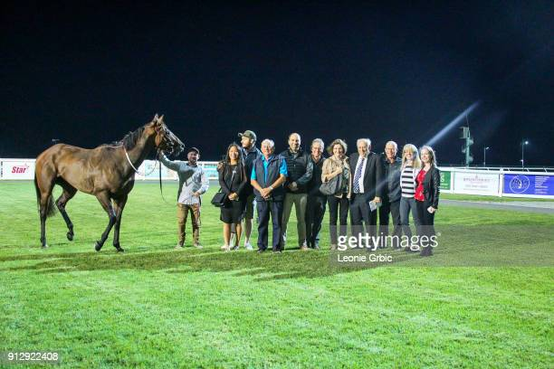 Connections pose with Lara's Web after winning the XXXX Gold FM BM64 Handicap at Racingcom Park Racecourse on February 01 2018 in Pakenham Australia