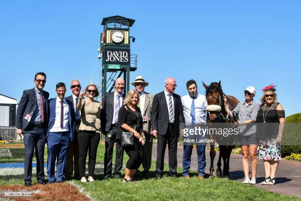 Connections pose with Steel Frost after winning the Ladbrokes Odds Boost Exotics Handicap at Caulfield Racecourse on October 18 2017 in Caulfield...