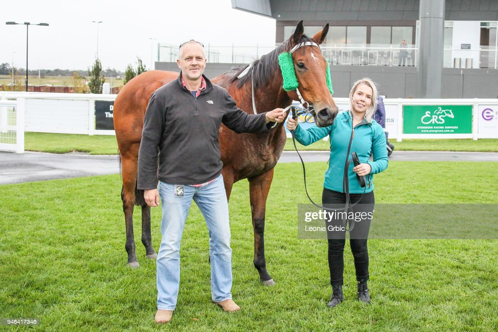 Connections pose with Surprise Hero after winning the Racing.com BM58 Handicap at Racing.com Park Synthetic Racecourse on April 15, 2018 in Pakenham, Australia.