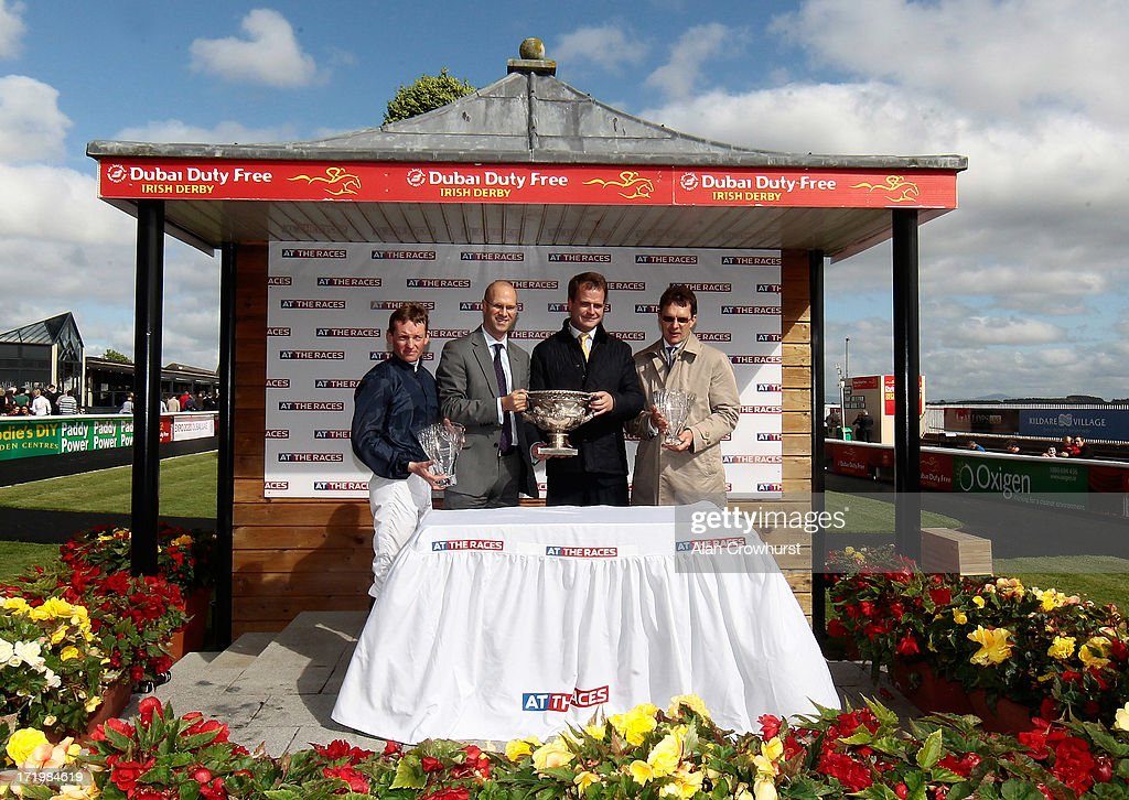 Connections with the trophy for The At The Races Curragh Cup at Curragh racecourse on June 30, 2013 in Kildare, Ireland.