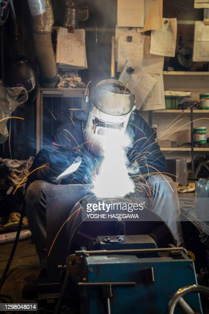 connections with welding contractors fighting in crisis situations. - recessed lighting stock pictures, royalty-free photos & images