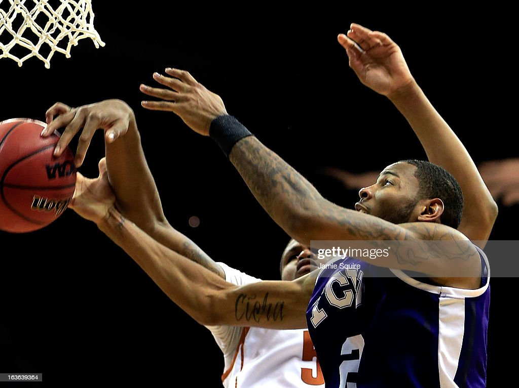 Connell Crossland #2 of the TCU Horned Frogs and Jaylen Bond #5 of the Texas Longhorns battle for a rebound during the first round of the 2013 Big 12 Men's Basketball Championship at Sprint Center on March 13, 2013 in Kansas City, Missouri.