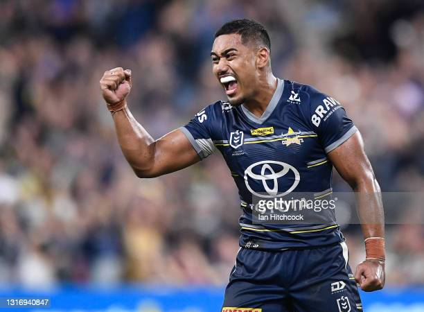 Connelly Lemuelu of the Cowboys celebrates after winning the round nine NRL match between the North Queensland Cowboys and the Brisbane Broncos at...