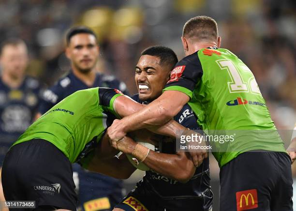 Connelly Lemuelu of the Cowboys is tackled by Jack Wighton and Elliott Whitehead of the Raiders during the round seven NRL match between the North...