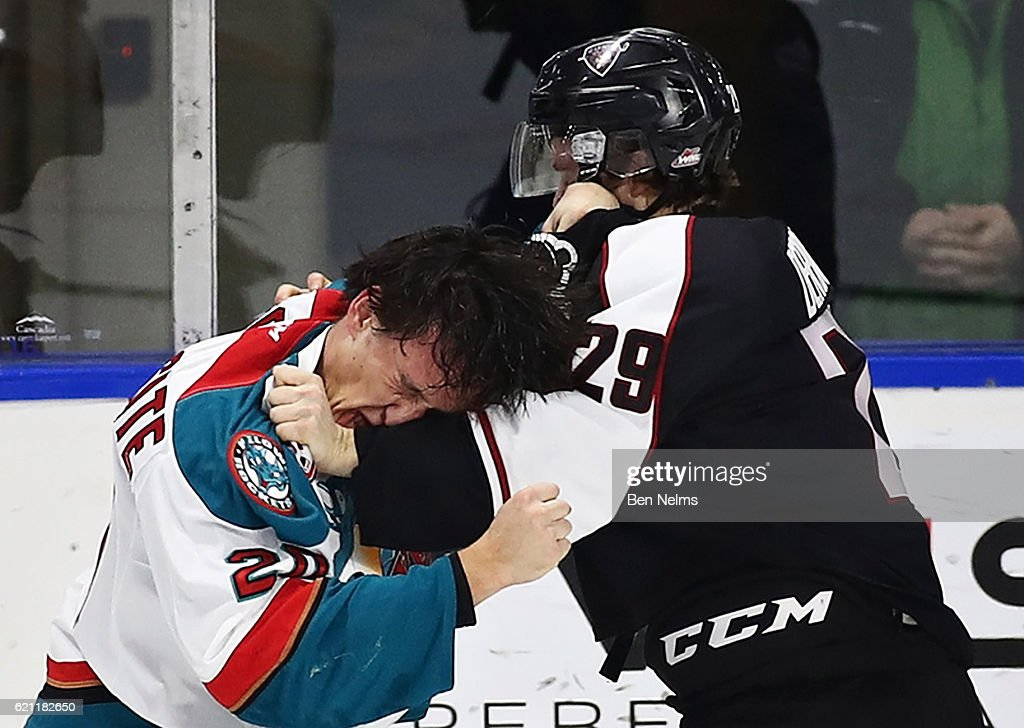 Conner Bruggen-Cate #20 of the Kelowna Rockets fights Tristyn DeRoose #29 of the Vancouver Giants during the first period of their WHL game at the Langley Events Centre on November 4, 2016 in Langley, British Columbia, Canada.