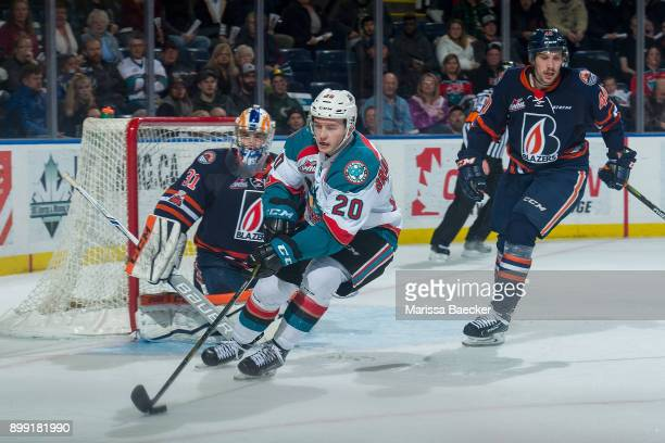Conner BruggenCate of the Kelowna Rockets skates with the puck past Dylan Ferguson of the Kamloops Blazers during third period on December 27 2017 at...