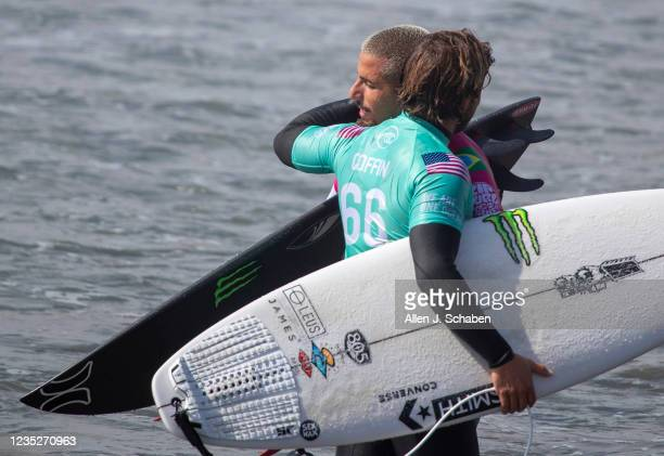 Conner Coffin, right, of Santa Barbara, and Filipe Toledo, of Brazil, hug after Toledo beat Coffin in the Rip Curl WSL Finals Tuesday, Sept. 14, 2021...