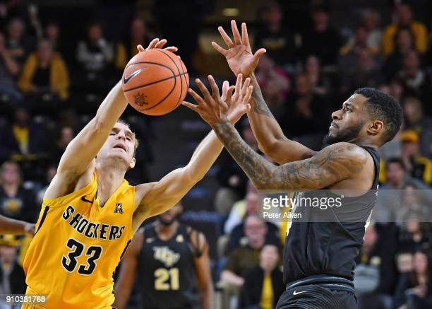Conner Frankamp of the Wichita State Shockers reaches for a loose ball against Ceasar DeJesus of the UCF Knights during the second half on January 25...