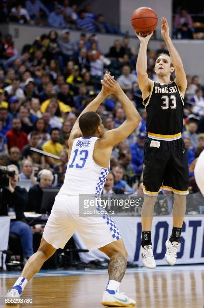 Conner Frankamp of the Wichita State Shockers shoots against Isaiah Briscoe of the Kentucky Wildcats in the second half during the second round of...