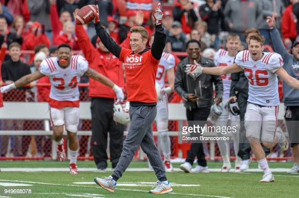 Conner Kranda a student of the Nebraska Cornhuskers celebrates after catching a punt to win winning $25000 during a break in the fourth quarter at...