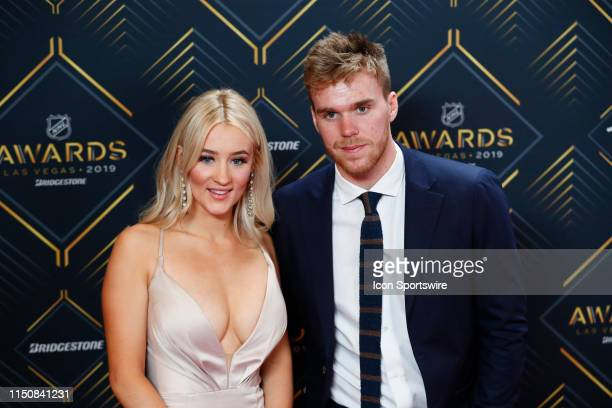 Conner McDavid of the Edmonton Oilers poses for photos on the red carpet with his girlfriend Lauren Kyle during the 2019 NHL Awards at Mandalay Bay...