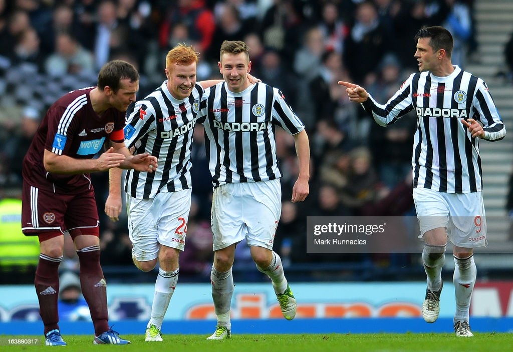 Conner Newton, Paul Dummet and Steven Thomson of St Mirren celebrate Conner Newtons winning goal in the Scottish Communities League Cup Final between St Mirren and Hearts at Hampden Park on March 17, 2013 in Glasgow, Scotland.