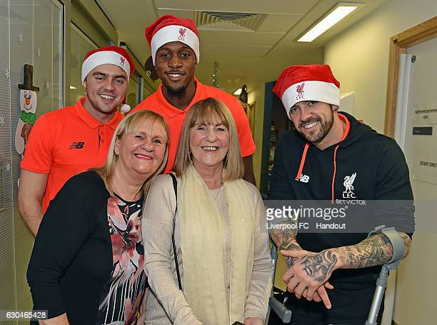 Conner Randall Divock Origi and Danny Ings of Liverpool at Alder Hey Children's Hospital on December 23 2016 in Liverpool England