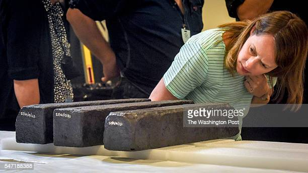 Connie Beninghove assistant registrar inspects Iron ballast bars recovered from a shipwrecked slave ship and destined for the African American musuem...