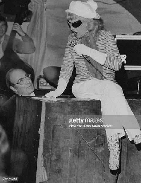 Connie Boswell during her last public performance sings from atop a piano