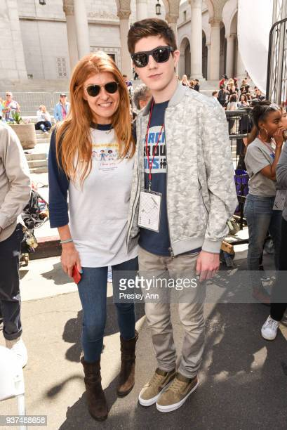 Connie Britton and Mason Cook attend March For Our Lives Los Angeles on March 24 2018 in Los Angeles California