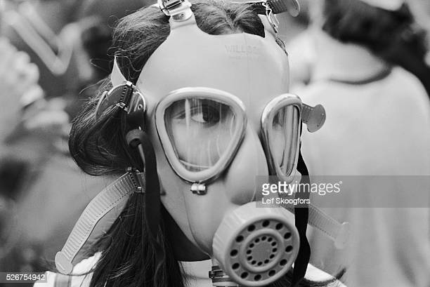 Connie Chung wears a gas mask near the White House while she covers the protest for the Vietnam War and the students killed by the National Guard at...