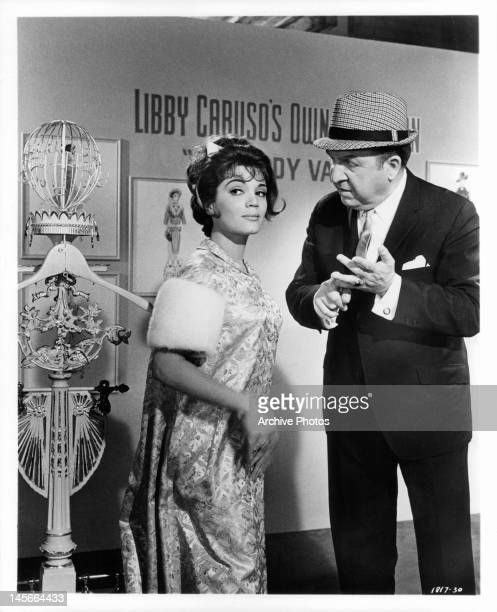 Connie Francis poses for stills while Jesse White offers suggestions in a scene from the film 'Looking For Love' 1964