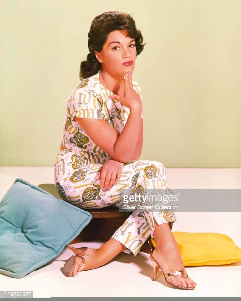 Connie Francis US pop singer sitting with her hand on her chin in a studio portrait circa 1955