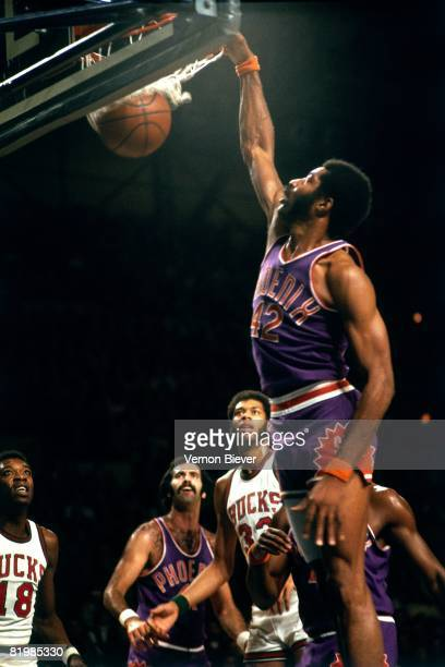 Connie Hawkins of the Phoenix Suns dunks against the Milwaukee Bucks during the 1972 season at the MECCA Arena in Milwaukee Wisconsin NOTE TO USER...