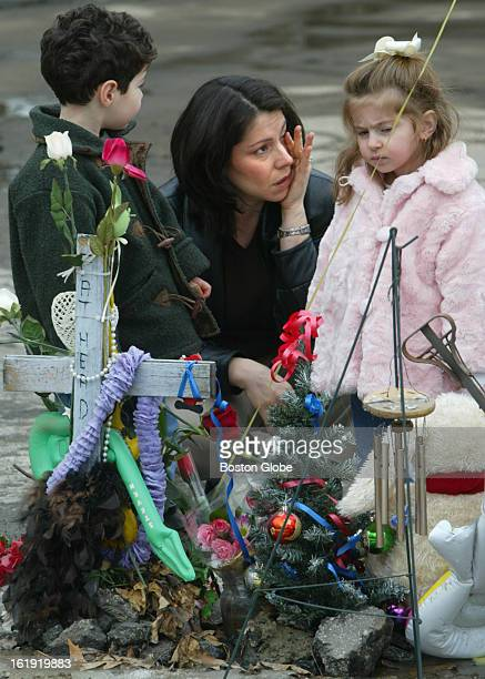 Connie Jacavone of Cranston wipes a tear at the memorial marking her husband's sister and brother in law who died at the Station nightclub fire one...