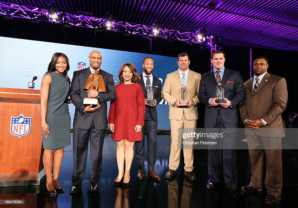 Connie Payton (3rdL), wife of former Chicago Bears great Walter Payton, her son Jarrett and daughter Brittney (L) and NFL Vice President of Player Engagement Troy Vincent (R) pose with the finalists for the Walter Payton Man of the Year award; Larry Fitzgerald (C) of the Arizona Cardinals, Joe Thomas (3rdR) of the Cleveland Browns and Jason Witten (2ndR) of the Dallas Cowboys during a press conference for Super Bowl XLVII at the Ernest N. Morial Convention Center on February 1, 2013 in New Orleans, Louisiana.