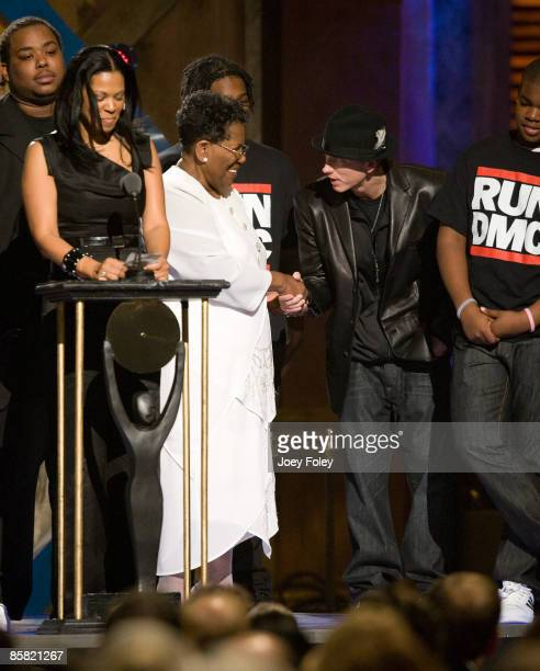 Connie Perry mother of deceased Jason 'Jam Master Jay' Mizell shakes hands with Eminem during the 24th Annual Rock and Roll Hall of Fame Induction...