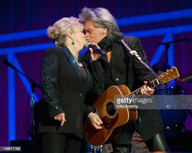 Connie Smith and her husband Marty Stuart kiss during Marty Stuart's 11th annual Late Night Jamat the Ryman Auditorium on June 7 2012 in Nashville...