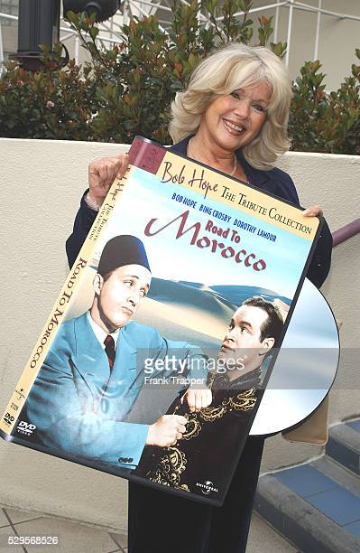 Connie Stevens holds a gigantic DVD box mockup of Bob Hope's famous movie 'The Road to Morocco' at the Hollywood Walk of Fame ceremony naming Bob...