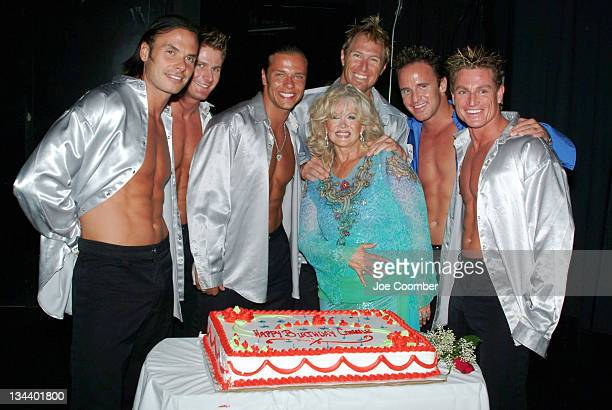 Connie Stevens receives a birthday cake from the cast of The Thunder Down Under