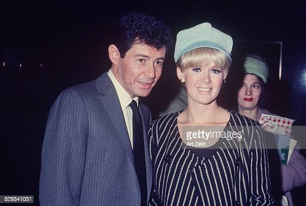 Connie Stevens with Eddie Fisher. She is wearing a blue and white striped jacket; circa 1970; New York.