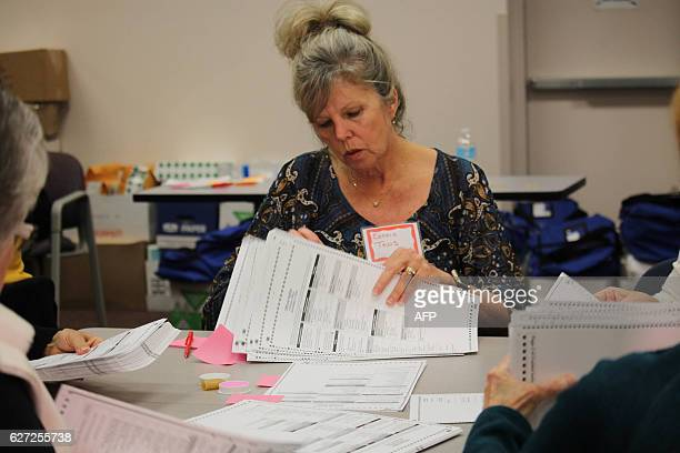 Connie Tews counts ballots in Kenosha Wisconsin on December 2 as part of a historic effort is being undertaken at the request of Green Party...