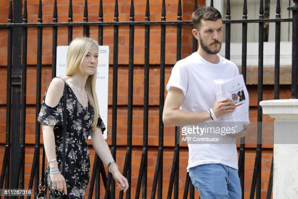 Connie Yates and Chris Gard parents of terminallyill 10monthold Charlie Gard carry a petition of signatures supporting their case prior to presenting...