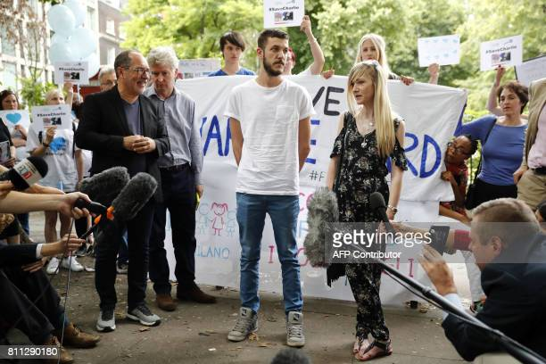Connie Yates and Chris Gard parents of terminallyill 10monthold Charlie Gard are surrounded by supporters prior to delivering a petition of...