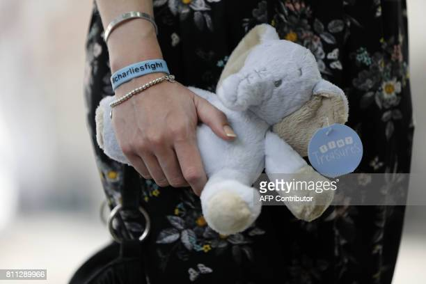 Connie Yates mother of terminallyill 10monthold Charlie Gard carries a soft toy after delivering a petition of signatures supporting their case to...