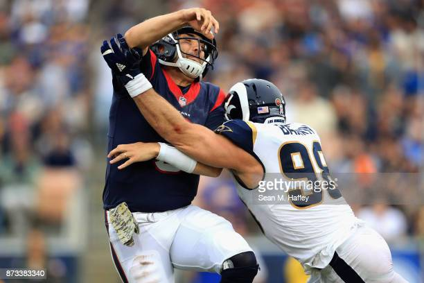 Connor Barwin of the Los Angeles Rams hits Tom Savage of the Houston Texans during the second half of game at Los Angeles Memorial Coliseum on...
