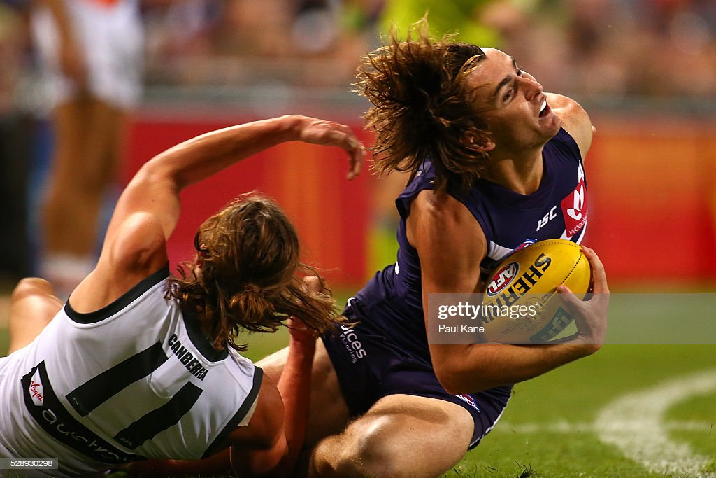 Connor Blakely of the Dockers gets tackled across the boundary by Jack Steele of the Giants during the round seven AFL match between the Fremantle Dockers and the Greater Western Sydney Giants at Domain Stadium on May 7, 2016 in Perth, Australia.
