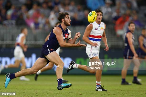 Connor Blakely of the Dockers handballs during the round five AFL match between the Fremantle Dockers and the Western Bulldogs at Optus Stadium on...