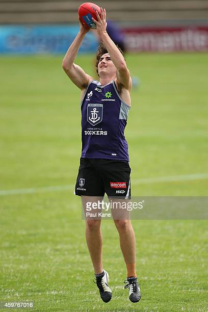 Connor Blakely of the Dockers marks the ball during a Fremantle Dockers AFL preseason training session at Fremantle Oval on December 1 2014 in...