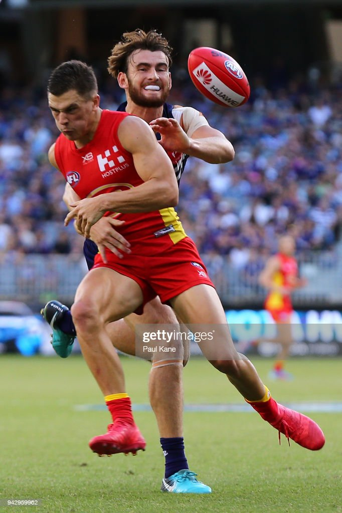 Connor Blakely of the Dockers spoils the mark for Ben Ainsworth of the Suns during the round three AFL match between the Gold Coast Suns and the Fremantle Dockers at Optus Stadium on April 7, 2018 in Perth, Australia.