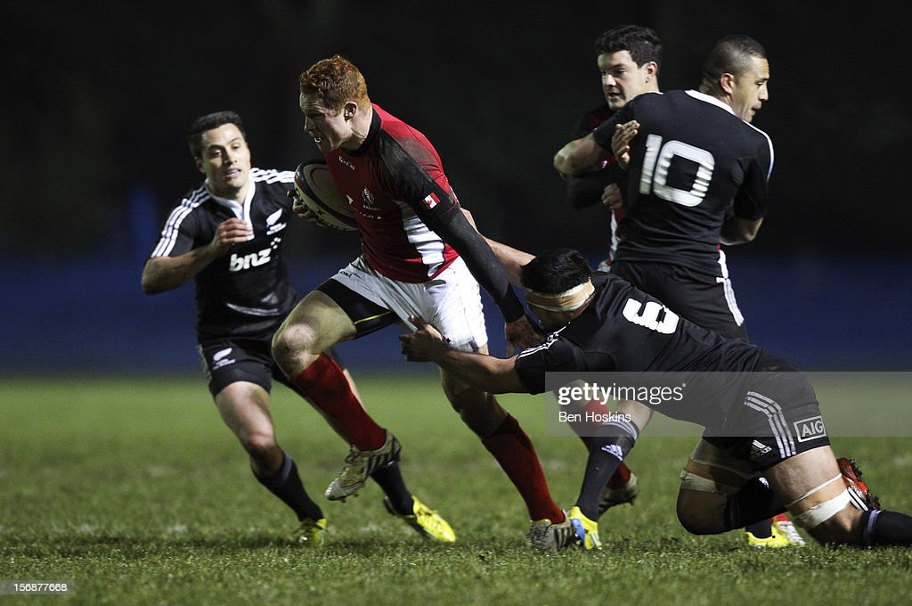 Connor Braid of Canada is tackled by Shane Christie of the Maori All Blacks during a tour match between Canada and Maori All Blacks at Oxford University Rugby Club on November 23, 2012 in Oxford, England.