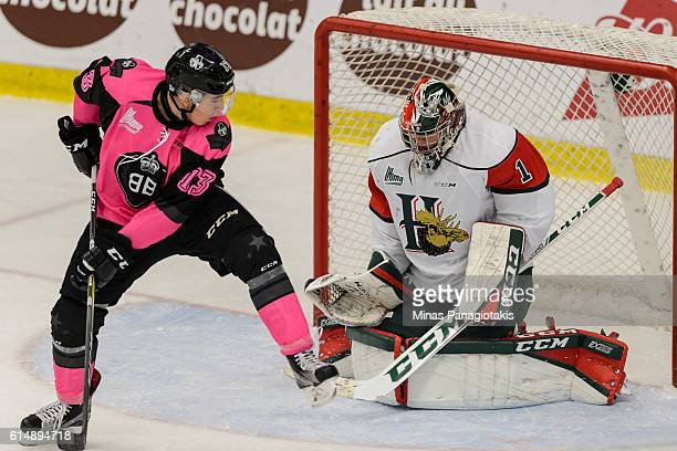 Connor Bramwell of the BlainvilleBoisbriand Armada redirects the puck towards goaltender Alexis Gravel of the Halifax Mooseheads during the QMJHL...