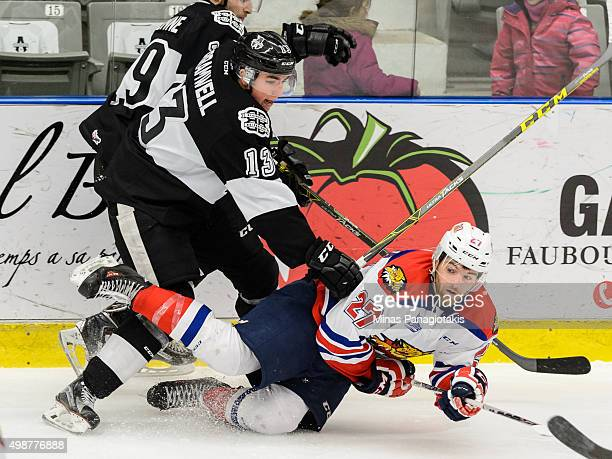 Connor Bramwell of the Blainville-Boisbriand Armada takes down Zachary Malatesta of the Moncton Wildcats during the QMJHL game at the Centre...