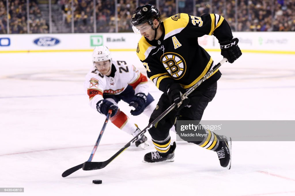 Connor Brickley #23 of the Florida Panthers defends Patrice Bergeron #37 of the Boston Bruins during the third period at TD Garden on April 8, 2018 in Boston, Massachusetts. The Panthers defeat the Bruins 4-2.