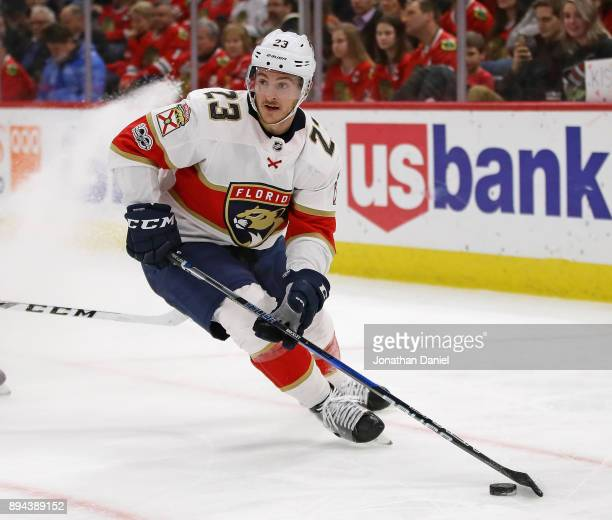 Connor Brickley of the Florida Panthers looks to pass against the Chicago Blackhawks at the United Center on December 12 2017 in Chicago Illinois The...