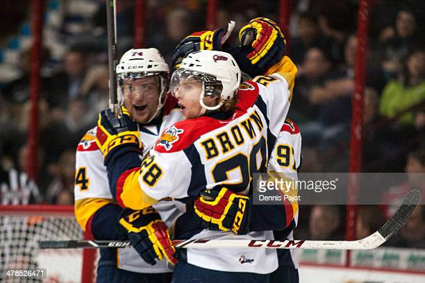 Connor Brown and Brendan Gaunce of the Erie Otters celebrate a goal against the Windsor Spitfires on March 13 2014 at the WFCU Centre in Windsor...