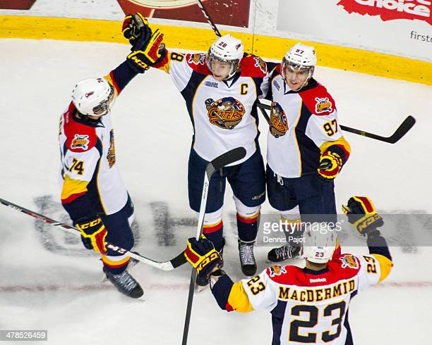 Connor Brown and Connor McDavid of the Erie Otters celebrate a goal against the Windsor Spitfires on March 13, 2014 at the WFCU Centre in Windsor,...