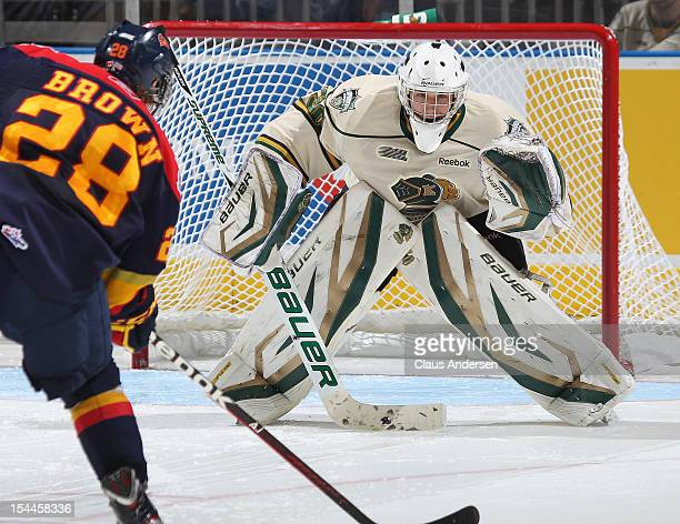 Connor Brown of the Erie Otters skates in and gets set to put the shootout winner past Kevin Bailie of the London Knights in an OHL game on October...