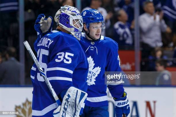 Connor Brown of the Toronto Maple Leafs celebrates with Curtis McElhinney after defeating the Montreal Canadiens at the Air Canada Centre on March 17...
